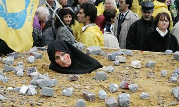 Iranian woman protest in Brussels highlighting barbarous practice of stoning - Photograph: Thierry Roge/Reuters